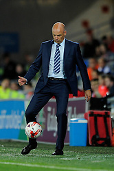 Wigan Athletic Manager, Uwe Rosler controls the ball - Photo mandatory by-line: Dougie Allward/JMP - Mobile: 07966 386802 19/08/2014 - SPORT - FOOTBALL - Cardiff - Cardiff City Stadium - Cardiff City v Wigan Athletic - Sky Bet Championship