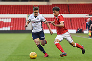 Bolton's U23 Dennis Politic and Nottingham Forest U23's Brennan Johnson during the U23 Professional Development League Play-Off Final match between Nottingham Forest and Bolton Wanderers at the City Ground, Nottingham, England on 4 May 2018. Picture by Jon Hobley.