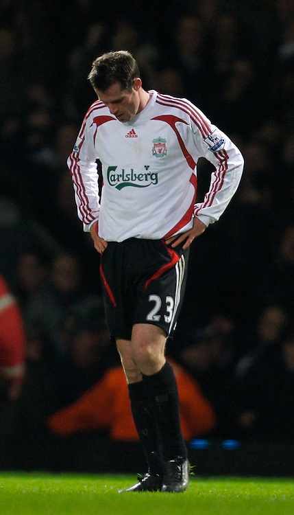 LONDON, ENGLAND - Wednesday, January 30, 2008: Liverpool's Jamie Carragher looks dejected after losing to a dodgy penalty for West Ham United during the Premiership match at Upton Park. (Photo by David Rawcliffe/Propaganda)