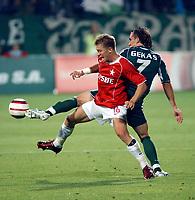 Fotball<br /> Foto: Wrofoto/Digitalsport<br /> NORWAY ONLY<br /> <br /> UEFA Champions League third qualifying round soccer match in Krakow, Poland, on Tuesday, Aug. 9, 2005<br /> WISLA KRAKOW v PANATHINAIKOS ATHENS<br /> KRAKOW 09/08/2005<br /> <br /> JAKUB BLASZCZYKOWSKI / WISLA / THEOFANIS GEKAS / PANATHINAIKOS