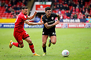 Barnsley midfielder Alex Mowatt goes past Walsall FC midfielder Zeli Ismail (10) during the EFL Sky Bet League 1 match between Walsall and Barnsley at the Banks's Stadium, Walsall, England on 23 March 2019.