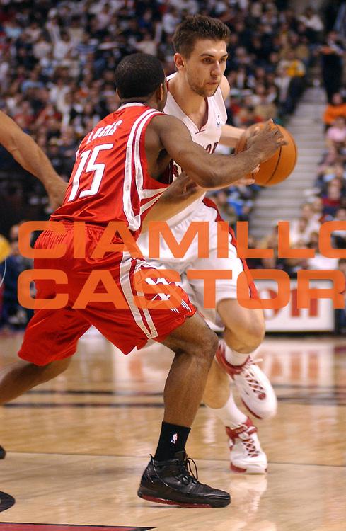 DESCRIZIONE : Toronto Campionato NBA 2006-2007 Toronto Raptors Houston Rockets<br /> GIOCATORE : Bargnani<br /> SQUADRA : Toronto Raptors <br /> EVENTO : Campionato NBA 2006-2007 <br /> GARA : Toronto Raptors Houston Rockets<br /> DATA : 16/03/2007 <br /> CATEGORIA : <br /> SPORT : Pallacanestro <br /> AUTORE : Agenzia Ciamillo-Castoria/V.Keslassy<br /> Galleria : NBA 2006-2007 <br /> Fotonotizia : Toronto Campionato NBA 2006-2007 Toronto Raptors Houston Rockets<br /> Predefinita : si
