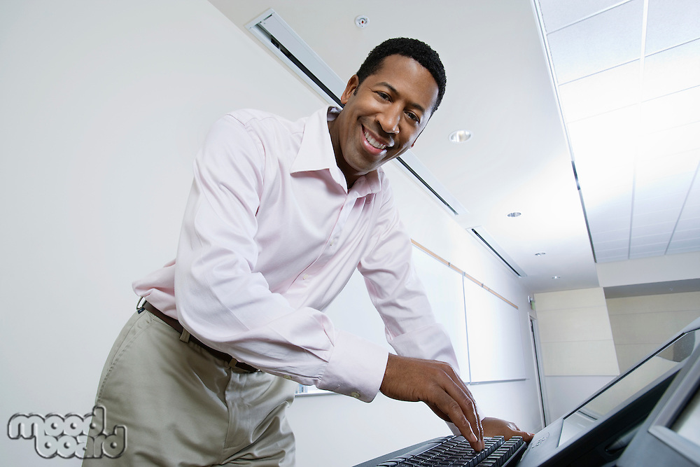 Male lecturer using computer