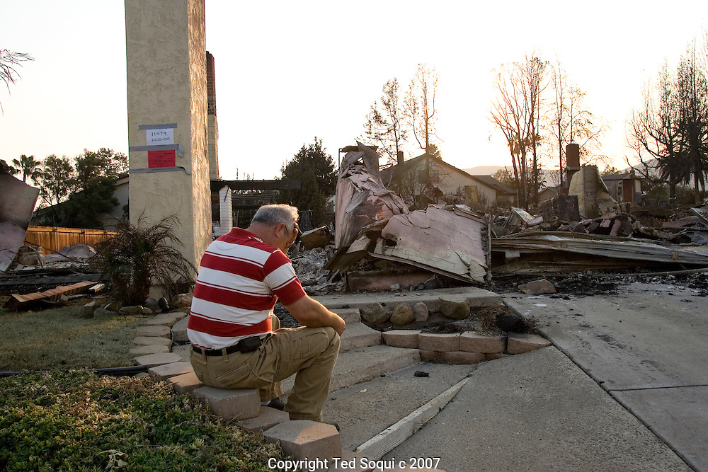 San Diego area wild fires..Rancho Bernardo resident Oscar Afshari surveys what is left of his 5 bedroom two story house. The house was completely destroyed by wild fire. He just finished remodeling his home 2 weeks ago..11467 Duenda Road, Rancho Bernardo, CA