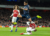 Football - 2018 / 2019 FA Cup - Fourth Round: Arsenal vs. Manchester United <br /> <br /> Henrikh Mkhitaryan (Arsenal FC) rises over the sliding tackle of Ainsley Maitland-Niles (Arsenal FC) at The Emirates Stadium.<br /> <br /> COLORSPORT/DANIEL BEARHAM
