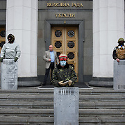 KIEV, UKRAINE - February 22, 2014: Members of the Maidan defence group take guard at the main entrance of the Ukrainian parliament building in Kiev. CREDIT: Paulo Nunes dos Santos
