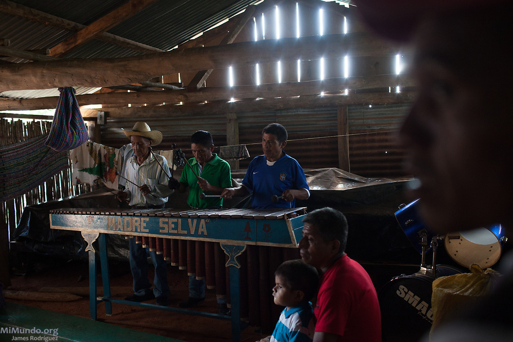 Locals from Pinares gather and play the marimba before Cahabon's community consultation on extractive projects. In Cahabon, the Oxec hydro-electric projects have begun construction without a proper consultation, an issue that has caused severe divisions among the local population. Out of a population of 70,000 in Cahabon, 26,526 voted against the extractive projects while 11 voted in favor. The consultation was not sanctioned by official authorities. Since 2005, over 90 consultation processes have been carried out in indigenous territories in Guatemalan. These are considered a preventive measure in the struggle to protect indigenous territories and their cultures from unwanted industrial projects. Pinares, Cahabon, Alta Verapaz, Guatemala. August 27, 2017.