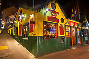 'Irish pub'  & pizzaria lit up at night, old cafe on main street, Ushuaia, Argentina.