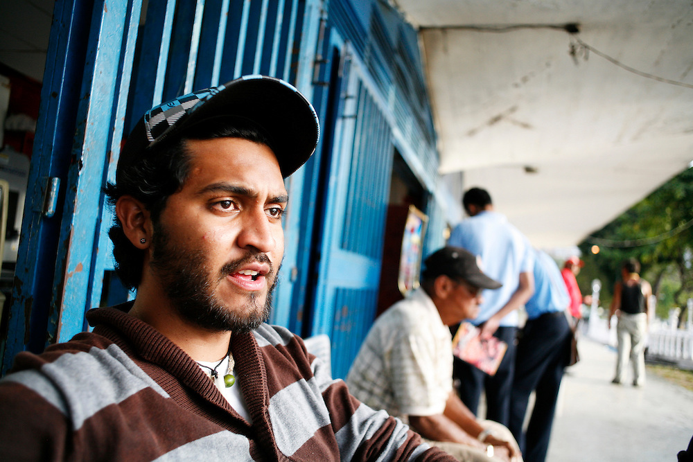 One of the leaders of Alexis Vive sits outside the bakery he runs with other members of the collective. The collective is supportive of the Chavez government, like many others in the barrio but believe in self-management and autonomy so the bakery serves as the primary funding of the group.