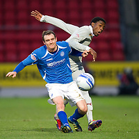 St Johnstone v Motherwell...10.12.11   SPL <br /> David Robertson and Omar Daley<br /> Picture by Graeme Hart.<br /> Copyright Perthshire Picture Agency<br /> Tel: 01738 623350  Mobile: 07990 594431