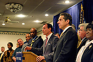 Albertson, New York, U.S. 26th October 2013. New York Governor ANDREW CUOMO, at right, endorses TOM SUOZZI, at podium, for Nassau County Executive, at the Albertson Veterans of Foreign Wars VFW Post. Democrat Suozzi, the former Nassau County Executive, and Republican incumbent Mangano face each other in a rematch in the upcoming November 5th election.