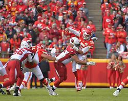 Nov 11, 2018; Kansas City, MO, USA; Kansas City Chiefs quarterback Patrick Mahomes (15) is hit by Arizona Cardinals defensive tackle Corey Peters (98) while throwing during the first half at Arrowhead Stadium. Mandatory Credit: Denny Medley-USA TODAY Sports