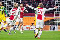 AMSTERDAM - Ajax - ADO , Voetbal , Eredivisie , Seizoen 2016/2017 , Amsterdam ArenA , 29-01-2017 ,  Ajax speler Hakim Ziyech (m) scoort de 1-0 en viert dit met Ajax speler Kasper Dolberg (l) en Ajax speler Lasse Schone (r)