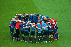 LENS, FRANCE - Thursday, June 16, 2016: Wales players form a post-match huddle after the 2-1 defeat to England during the UEFA Euro 2016 Championship Group B match at the Stade Bollaert-Delelis. James Chester, Andy King, Simon Church, Neil Taylor, captain Ashley Williams, David Cotterill. (Pic by Paul Greenwood/Propaganda)