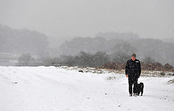© under license to London News Pictures. 30/11/2010. Ted Young and his dog walk through snow in Richmond park, London. Photo credit should read: Stephen Simpson/LNP