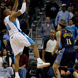 Dec 18, 2009; New Orleans, LA, USA;  New Orleans Hornets forward David West (30) shoots over Denver Nuggets center Chris Andersen (11) during the second half at the New Orleans Arena. The Hornets defeated the Nuggets 98-92. Mandatory Credit: Derick E. Hingle-US PRESSWIRE