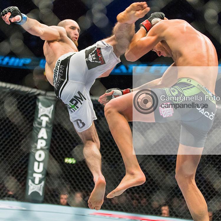 Stockholm 2013-04-06: <br /> <br /> Adlan Amagov hits Chris Spang with a series of roundhouse kicks at UFC on Fuel TV 9 held at Stockholm Ericsson Globe in Stockholm, Sweden<br /> <br /> (Photo: Michael Campanella / Pic-Agency)