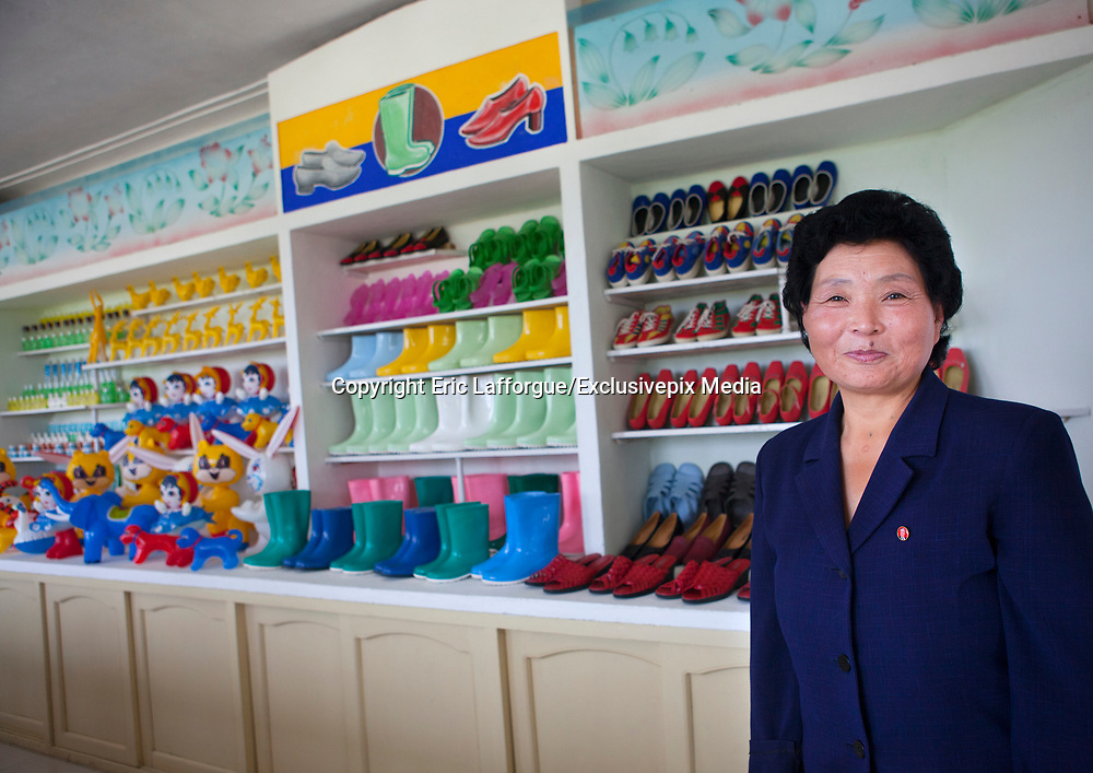 Fashion in North Korea<br /> <br /> In every corner of the earth, women love to look beautiful and keep up with the latest fashion trends. The women of North Korea are no different. Fashion is taken seriously here. But in North Korea, women do not read Elle or Vogue; they just glimpse a few styles by watching TV or by observing the few foreigners who come to visit. In the hermit kingdom, clothing also reflects social status. If you have foreign clothes it means you travel and are consequently close to the centralized power. Chinese products have inundated the country, adding some color to the traditional outfits that were made of vynalon fiber. But citizens beware, too much style means you're forgetting the North Korean juche, the ethos of self-reliance that the country is founded on! But the youth tend to neglect it despite the potential consequences.<br /> <br /> Photo shows: In a village near Hamhung, this shop shows the few clothing options available to the people. Their choice of footwear is limited to boots and simple shoes.  <br /> ©Eric Lafforgue/Exclusivepix Media