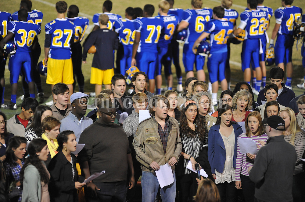 Students of former Oxford High teacher Ava Bonds sing the national anthem before Oxford High vs. Saltillo in Oxford, Miss. on Friday, October 19, 2012. Oxford won to improve to 9-0.