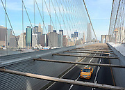 © licensed to London News Pictures. New York, USA  28/05/11.  A taxi passes along Brooklyn Bridge. Photo credit should read Stephen Simpson/LNP