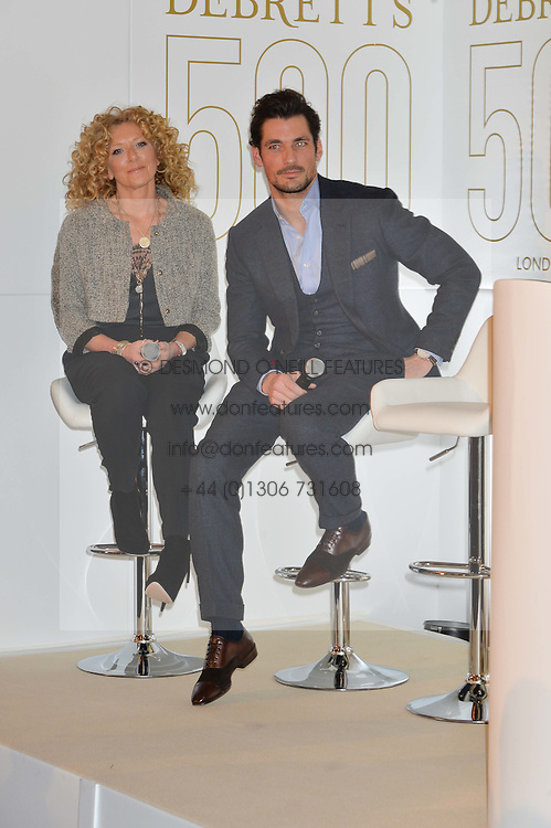 KELLY HOPPEN and DAVID GANDY at a reception to celebrate the Debrett's 500 2015 - a recognition of Britain's 500 most influential people, held at The Club at The Cafe Royal, 68 Regent Street, London on 26th January 2015.