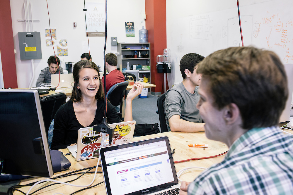 University of Maryland senior and director of Startup Shell, Mackenzie Burnett talks with incoming director Chris Szeluga, at the Startup Shell headquarters on the University of Maryland campus on April 1, 2015. Startup Shell is a not for profit company run entirely by and for students at UMD. Entrepreneurial students from all different disciplines apply to join and if accepted, can work on their innovative project with others collaborating and learning from one another.