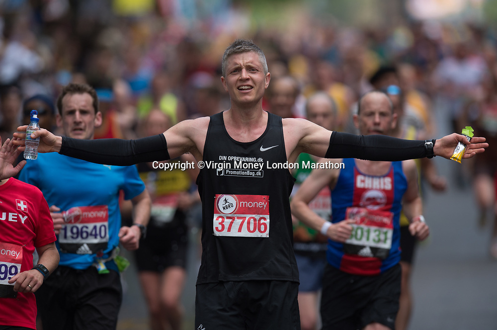 A runner with a bottle of Buxton water at Mile 22 during The Mass Event. The Virgin Money London Marathon, 23rd April 2017.<br /> <br /> Photo: Joe Toth for Virgin Money London Marathon<br /> <br /> For further information: media@londonmarathonevents.co.uk