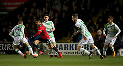 Manchester United's Alexis Sanchez (second left) in action during the Emirates FA Cup, fourth round match at Huish Park, Yeovil.
