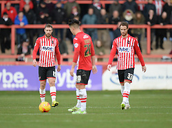Dejected Exeter City's Ryan Harley and Exeter City's David Noble walk back to the centre circle. - Photo mandatory by-line: Alex James/JMP - Mobile: 07966 386802 - 10/01/2015 - SPORT - football - Exeter - St James Park - Exeter City v Northampton - Sky Bet League Two
