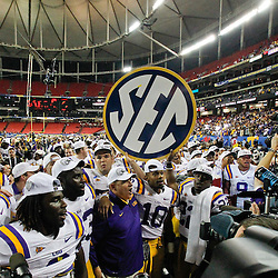 Dec 3, 2011; Atlanta, GA, USA; LSU Tigers head coach Les Miles and players celebrate following a win over the Georgia Bulldogs in the 2011 SEC championship game at the Georgia Dome.  Mandatory Credit: Derick E. Hingle-US PRESSWIRE