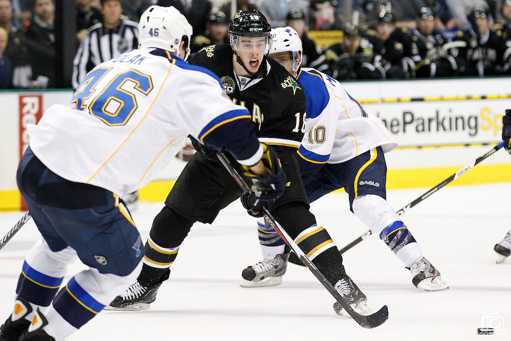 Dallas Stars right wing Reilly Smith (18) chases down a loose puck against St. Louis Blues defenseman Roman Polak (46) at the American Airlines Center in Dallas, Texas, on January 26, 2013.  (Stan Olszewski/The Dallas Morning News)