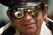A band member with his tuba reflected in his sunglasses while waiting for Mexican President Carlos Salinas de Gortari during a trip to the Yucatan, Mexico.
