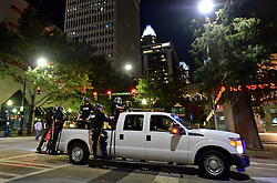 September 23, 2016 - Charlotte, NC, USA - A pickup truck carries Charlotte police officers through the streets of the city as they follow a protest march in Charlotte, N.C., on Friday, Sept. 23, 2016, as demonstrations continue following the shooting death of Keith Scott by police earlier in the week. (Credit Image: © Jeff Siner/TNS via ZUMA Wire)