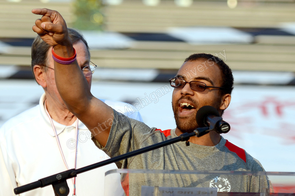The healthy athlete winner gives a recognition speech during the opening ceremony of the 2015 Michigan Summer Special Olympics photo by Claire Abendroth
