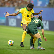 GRENOBLE, FRANCE June 18.  Hayley Raso #16 of Australia defended by Konya Plummer #5 of Jamaica during the Jamaica V Australia, Group C match at the FIFA Women's World Cup at Stade des Alpes on June 18th 2019 in Grenoble, France. (Photo by Tim Clayton/Corbis via Getty Images)