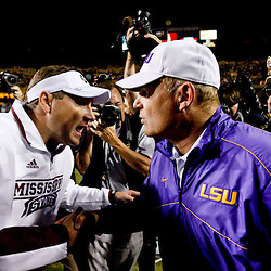 November 10, 2012; Baton Rouge, LA, USA; LSU Tigers head coach Les Miles and Mississippi State Bulldogs head coach Dan Mullen meet following a game at Tiger Stadium.  LSU defeated Mississippi State 37-17. Mandatory Credit: Derick E. Hingle-US PRESSWIRE
