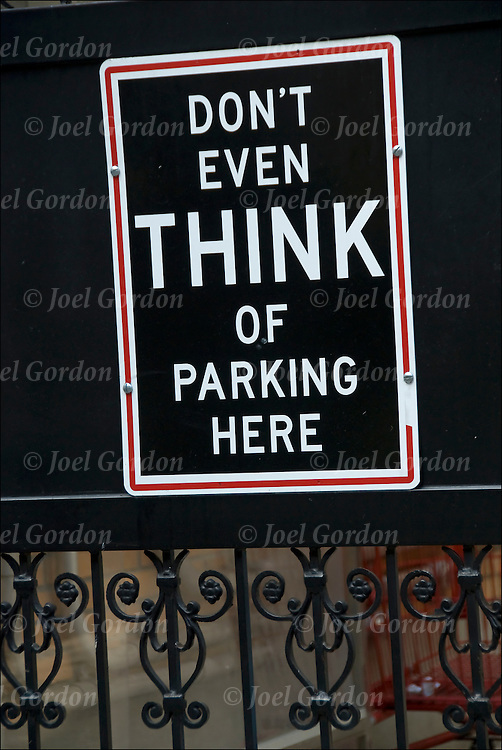 """Humorous sign on gate, """"Don't Even Think of Parking Here"""""""