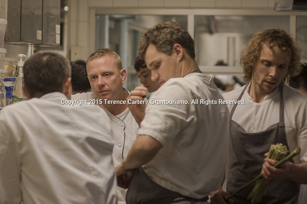 Executive Chef Chris Miller of The Metropolitan by COMO (second left) discusses logistics with his Head Chef Prin and Chef Beau of Noma. The 30-odd kitchen staff of Nahm are split into teams dedicated to prepping and delivering the sixteen dishes on the night. As midnight approaches some of the chefs are now beginning prep for tomorrow's dinner. Copyright 2015 Terence Carter / Grantourismo. All Rights Reserved.