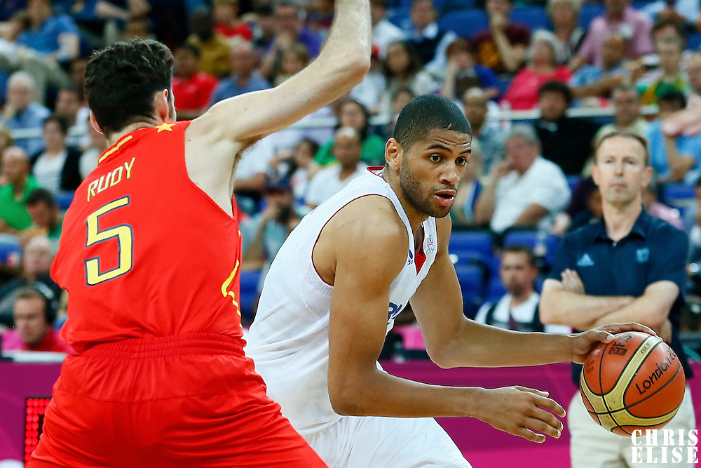 08 August 2012: France Nicolas Batum drives past Rudy Fernandez during 66-59 Team Spain victory over Team France, during the men's basketball quarter-finals, at the 02 Arena, in London, Great Britain.