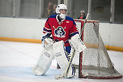 Fairport goaltender Ethan Kaiser watches the puck during a scrimmage against Victor at Thomas Creek in Fairport on Monday, November 24, 2014.