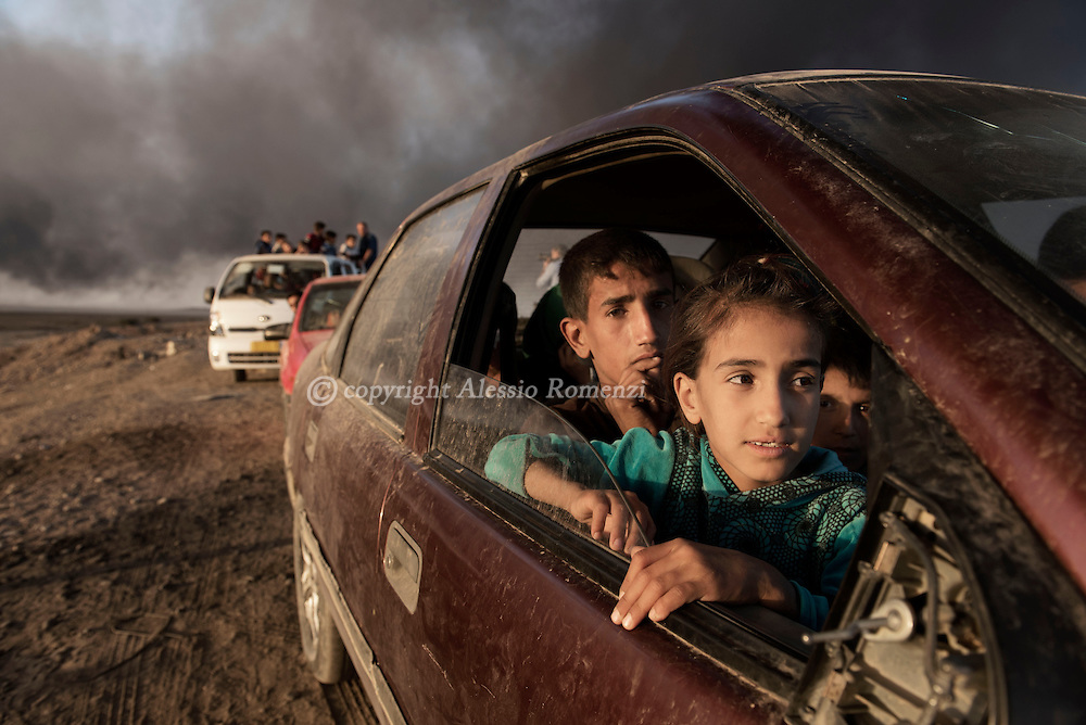 Iraq, Qarayya: Newly displaced children arrive at a check point in Qayyara, south of Mosul on October 31, 2016. Alessio Romenzi