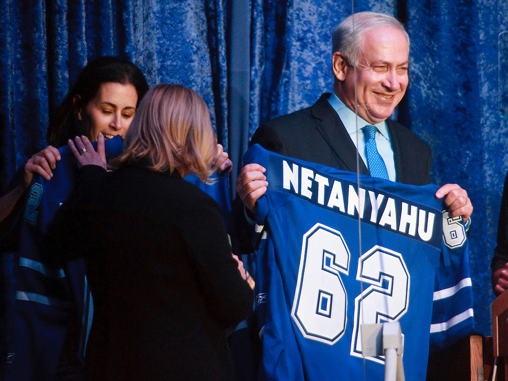 Israeli Prime Minister Benjamin Netenyahu is presented with a Toronto Maple Leafs sweater after speaking to participants in the Walk for Israel in Toronto, Ontario, Canada, May 30, 2010. Prime Minister Netenyahu is on a state visit to Canada, the first for an Israeli leader in 16 years.<br /> AFP/GEOFF ROBINS/STR