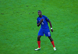 PARIS, FRANCE - Sunday, July 3, 2016: France's Paul Pogba celebrates scoring the second goal against Iceland during the UEFA Euro 2016 Championship Semi-Final match at the Stade de France. (Pic by Paul Greenwood/Propaganda)