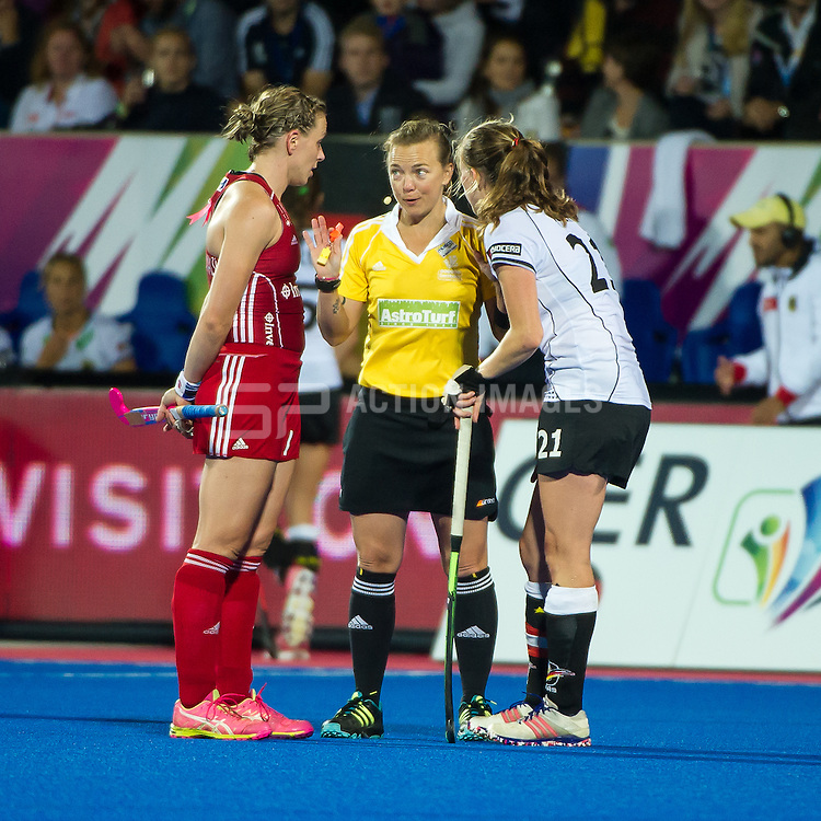 Umpire Amy Baxter speaks to captains Kate Richardson-Walsh and Franzisca Hauke. England v Germany - Unibet EuroHockey Championships, Lee Valley Hockey & Tennis Centre, London, UK on 26 August 2015. Photo: Simon Parker