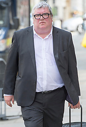 Image ©Licensed to i-Images Picture Agency. 04/07/2014. London, United Kingdom. Former News of the World Editor Greg Miskiw arrives for sentencing at the Old Bailey. Picture by i-Images