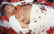 Mohondas Karamchand Gandhi  (1869-1948), known as Mahatma (Great Soul). Indian Nationalist leader. Gandhi 's body strewn with flowers.  Colour