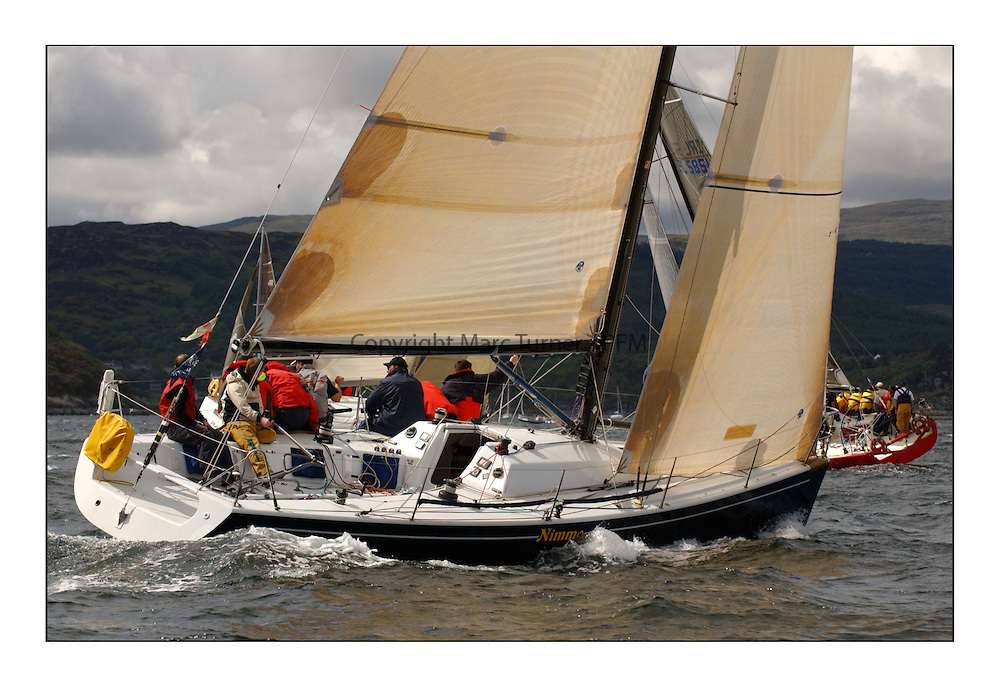 Yachting- The first days inshore racing  of the Bell Lawrie Scottish series 2003 at Tarbert Loch Fyne. Light shifty winds dominated the racing...Nimmo, a Dubois 37 from Galway to lee of the Class one fleet heading upwind...Pics Marc Turner / PFM