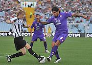 Udine, 18 Settembre 2011.Campionato di calcio Serie A 2011/2012  3^ giornata..Udinese vs Fiorentina. Stadio Friuli..Nella Foto: Dusan Basta e Vargas..© foto di Simone Ferraro