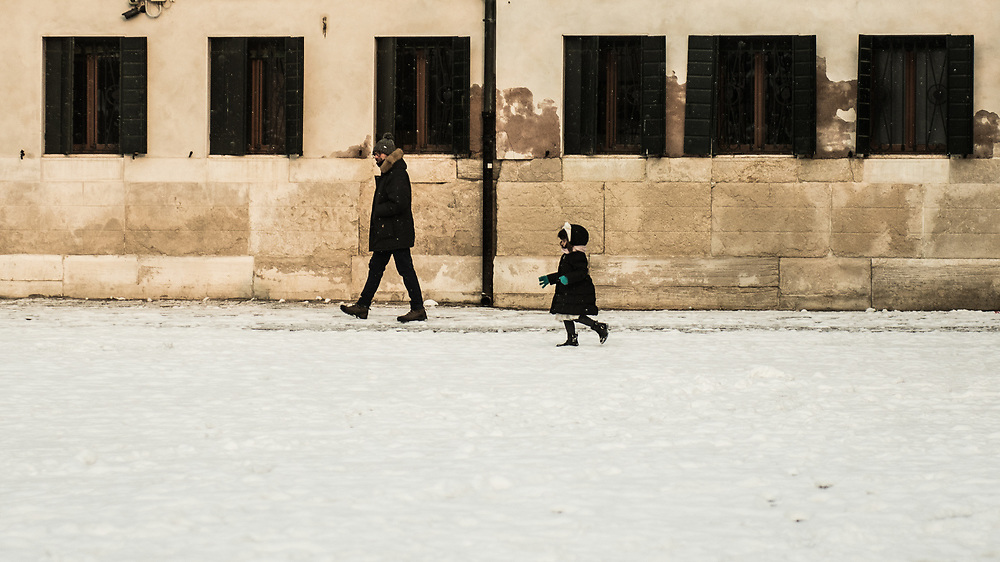 VENICE, ITALY - 28th FEBRUARY/01st MARCH 2018<br /> A little girl runs in the snow during a snowfall in Venice, Italy. A blast of freezing weather called the &ldquo;Beast from the East&rdquo; has gripped most of Europe in the middle of winter of 2018, and in Venice A snowfall has covered the city with white, making it fascinating and poetic for citizen and tourists.   &copy; Simone Padovani / Awakening
