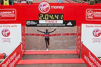 Eliud Kipchogee of Kenya crosses the line to win the Elite Mens race at the Virgin Money London Marathon , Sunday 26th April 2015.<br /> <br /> Dillon Bryden for Virgin Money London Marathon<br /> <br /> For more information please contact Penny Dain at pennyd@london-marathon.co.uk